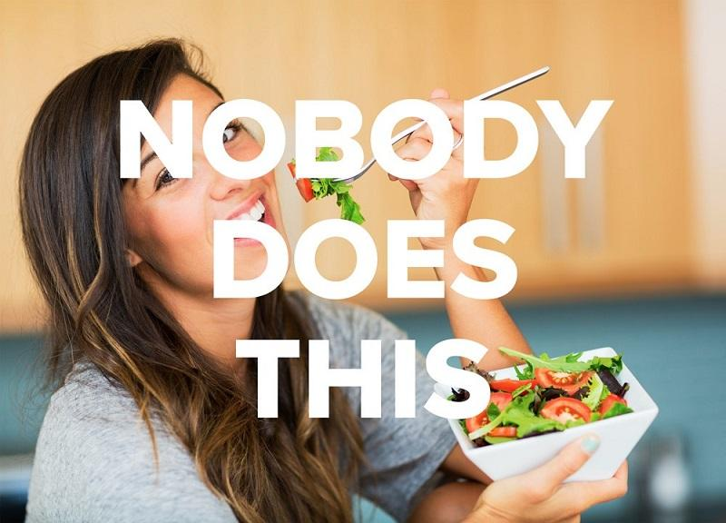"""happy woman eating salad with """"nobody does this"""" overlay"""