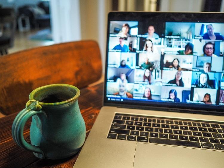 image of a video call on a laptop screen