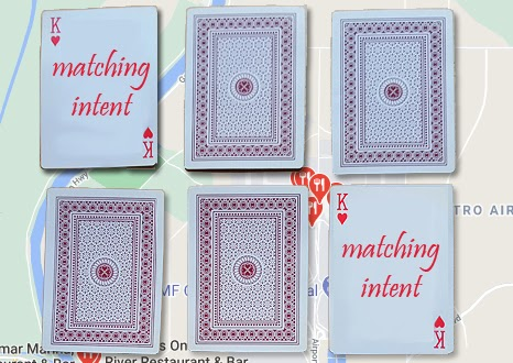 Playing cards on a Google Map background with